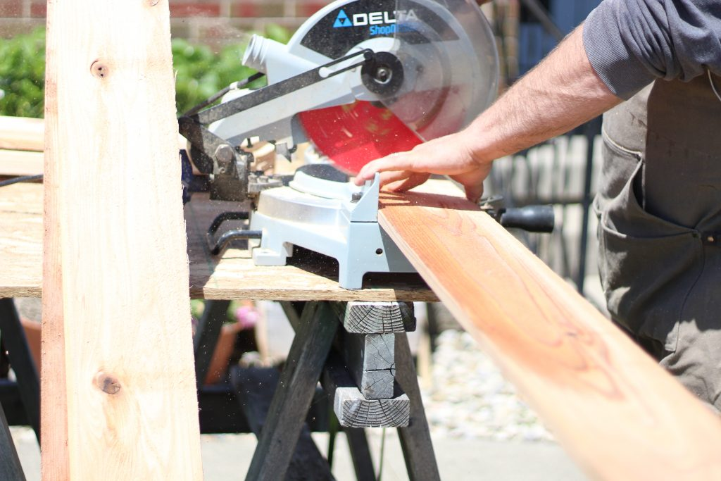 cutting wood for raised bed